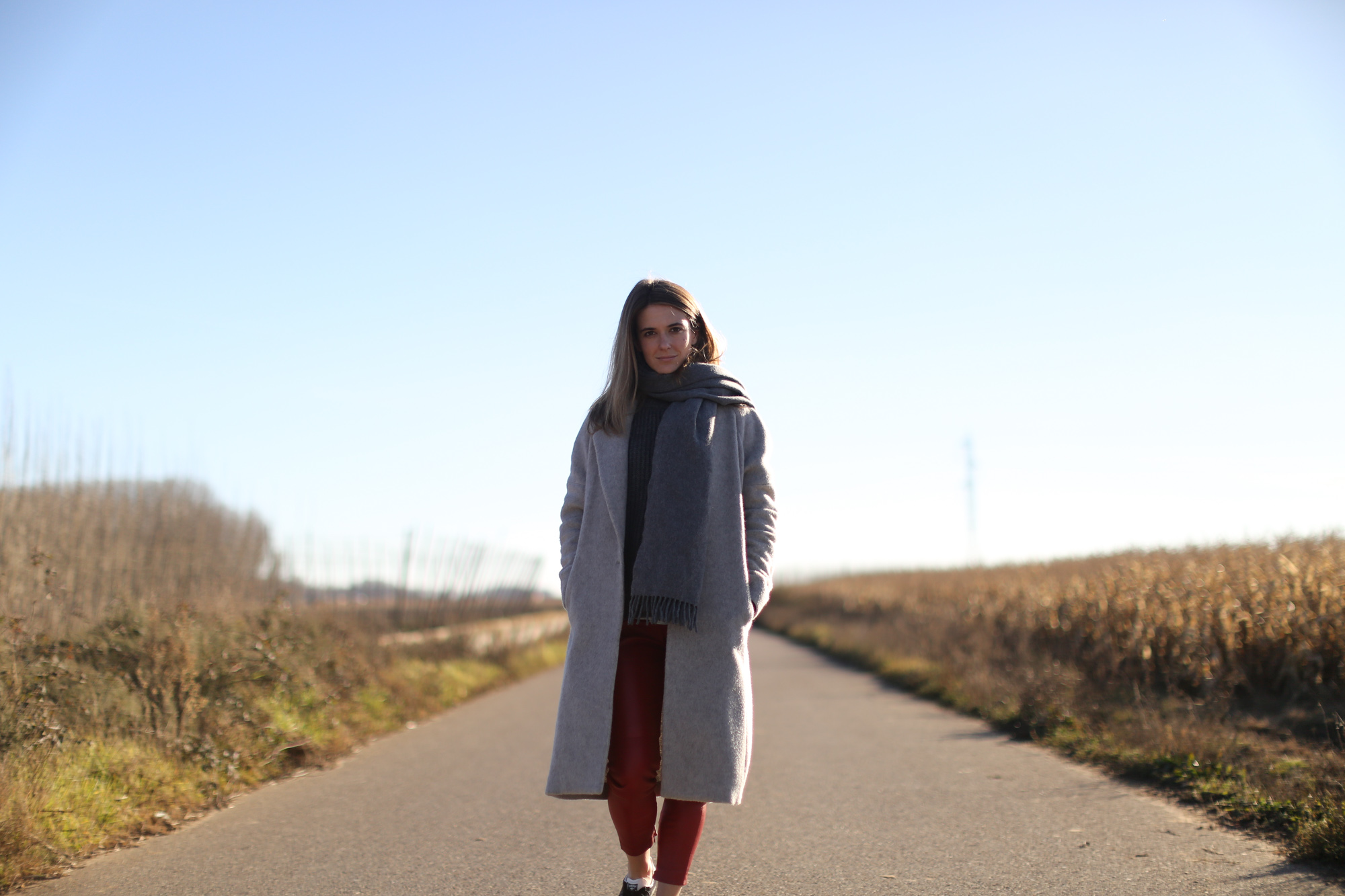 Clochet_streetstyle_mango_long_grey_coat_rd_leather_trousers_adidas_gazelle-1-2
